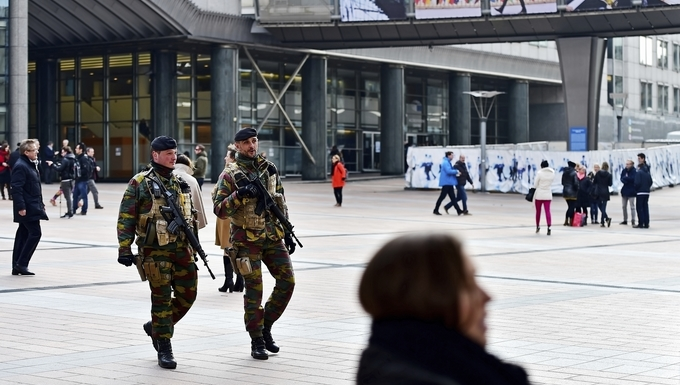 Brussels, Belgium - March 16, 2016: Belgian soldiers on patrol in European Parliament zone due to a raised level of a possible terror attack in Brussels.