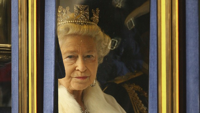 Queen Elizabeth II travels to Westminster for The State Opening of Parliament on December 3, 2008 in London. New legislation on crime and finance is expected to be announced in the Queen's speech in Parliament. (Photo by Peter Macdiarmid)